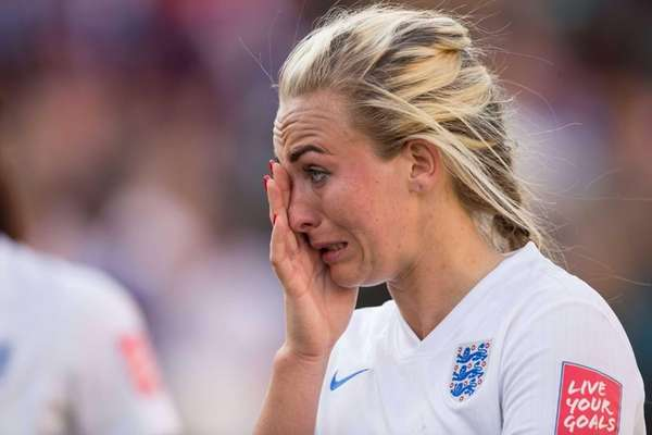 England's Toni Duggan wipes away a tear after