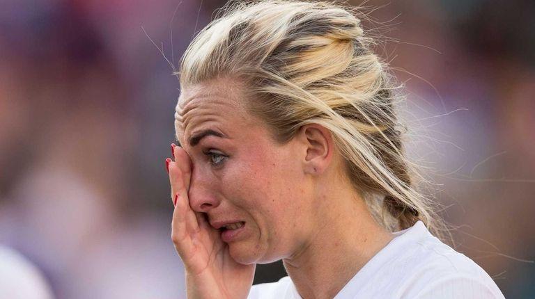 England's Toni Duggan wipes away a tear after