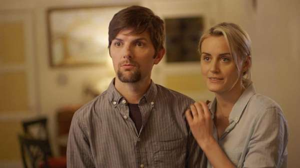 Adam Scott, left, and Taylor Schilling, in a