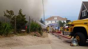 Firefighters battle a blaze at the Fire Island
