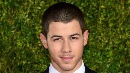 Nick Jonas attends the 2015 Tony Awards at