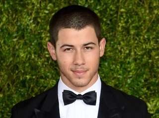 Nick Jonas attends the 2015 Tony Awards at