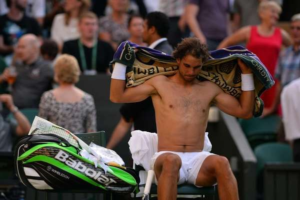 Spain's Rafael Nadal changes his shirt in the