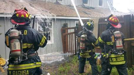 Firefighters battle a blaze that erupted in the
