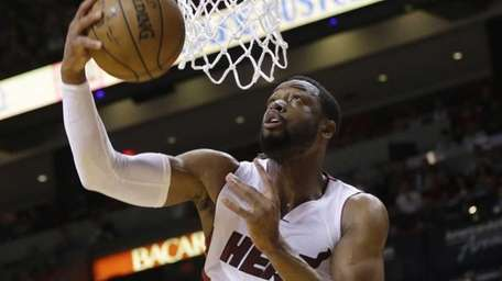 Miami Heat guard Dwyane Wade (3) shoots in