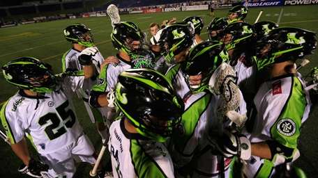 Members of the New York Lizards celebrate following