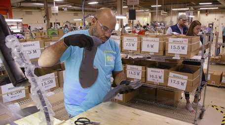 Loyd Johnson inspects a new pair of midsoles