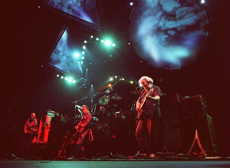 The Grateful Dead performs at the Oakland Coliseum