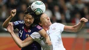 Team USA striker Abby Wambach, right, and Japan