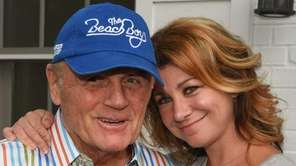 Bruce Johnston poses with Tara Ricart before The