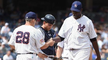 New York Yankees starting pitcher Michael Pineda hands