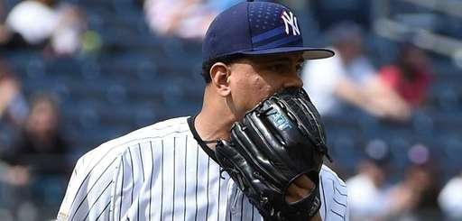 Yankees relief pitcher Dellin Betances reacts as Tampa