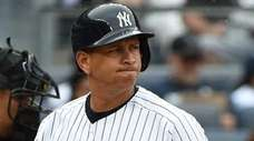 Yankees designated hitter Alex Rodriguez reacts after he