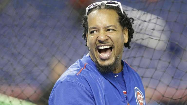 Chicago Cubs hitting consultant Manny Ramirez laughs as