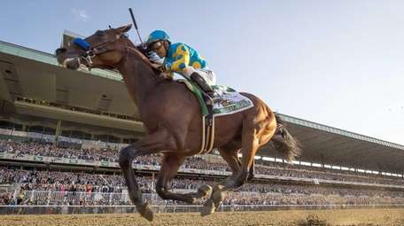 A file photo shows American Pharoah running his