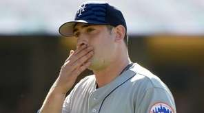Matt Harvey #33 of the Mets reacts as