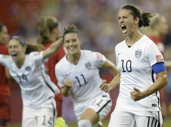 Team USA's Carli Lloyd, right, celebrates with teammates
