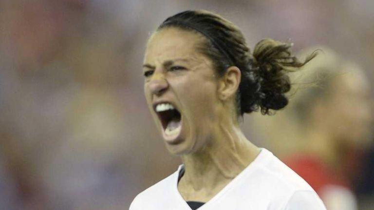Team USA's Carli Lloyd, right, celebrates with teammates