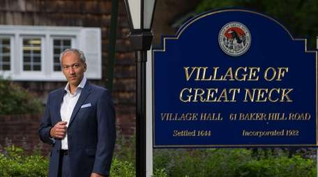 Standing outside of Great Neck Village Hall is