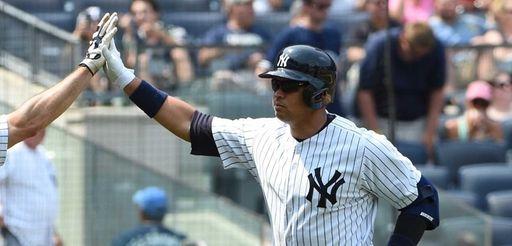 Yankees first baseman Mark Teixeira congratulates designated hitter