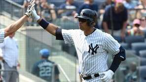 Yankees first baseman Mark Teixeira congratulates designated hitter