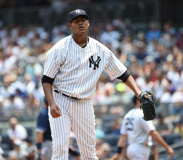 Yankees starting pitcher Ivan Nova reacts against the
