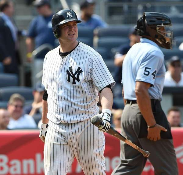 Yankees catcher Brian McCann walks to the dugout