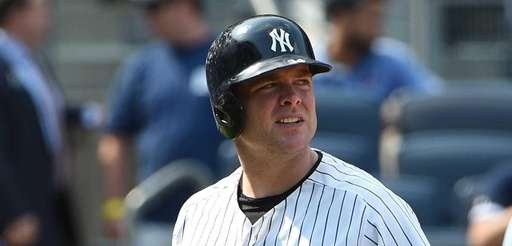 Yankees catcher Brian McCann walks to the dugout