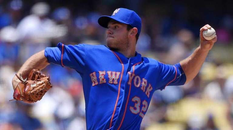 Mets starting pitcher Steven Matz throws to the