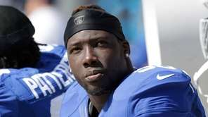 The Giants' Jason Pierre-Paul sits on the sidelines
