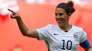 Carli Lloyd #10 of the United States celebrates