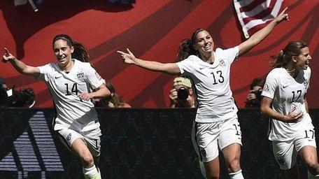 USA midfielder Carli Lloyd (10) celebrates her goal
