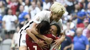 USA midfielder Carli Lloyd (10) is congratuled by