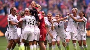 Abby Wambach #20 of the United States celebrates