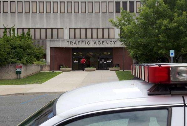 A deputy sheriff's car sits near the entrance