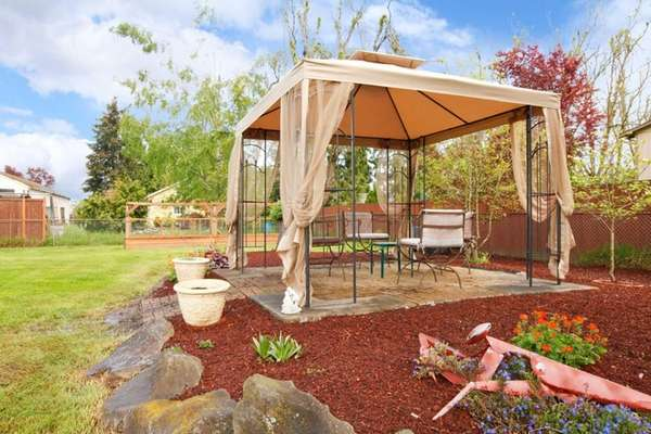 A gazebo with insect screens lets you enjoy