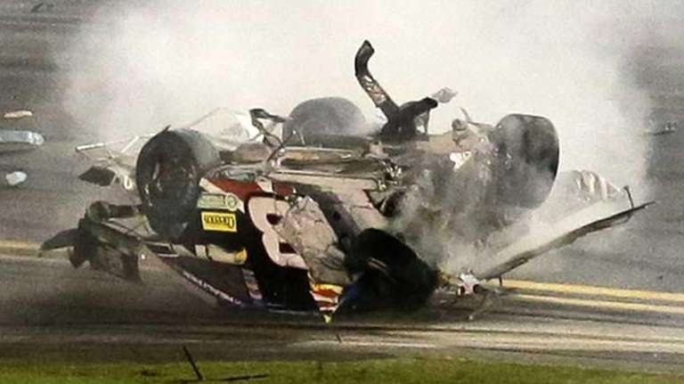 Austin Dillon tumbles down the front stretch as