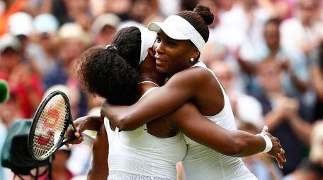 Serena Williams, left, hugs Venus Williams after their