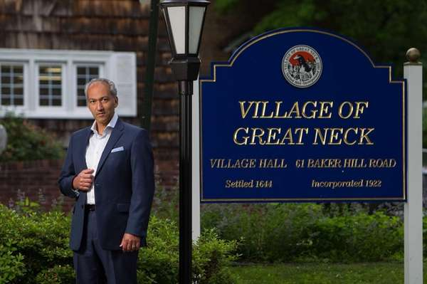 Pedram Bral stands outside Great Neck Village Hall