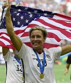 USA forward Abby Wambach celebrates after their victory