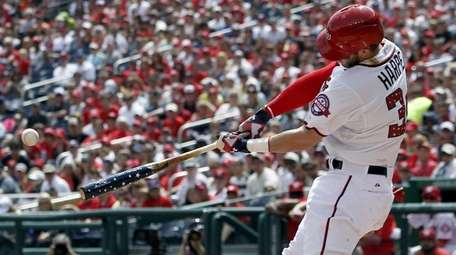 The Washington Nationals' Bryce Harper (34) hits a