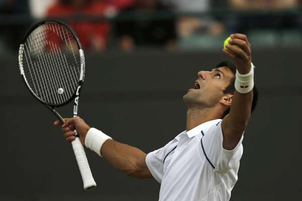 Novak Djokovic reacts after serving an ace against