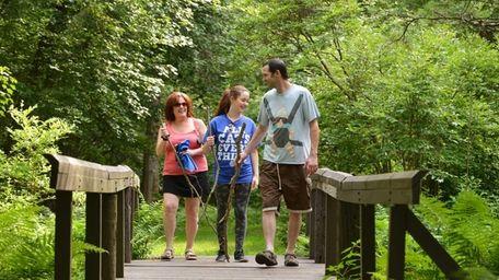 Hikers exploring Connetquot River State Park Preserve.