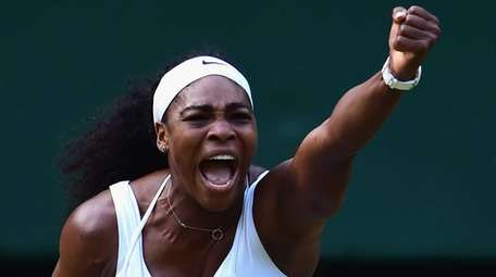 Serena Williams celebrates winning a point in her