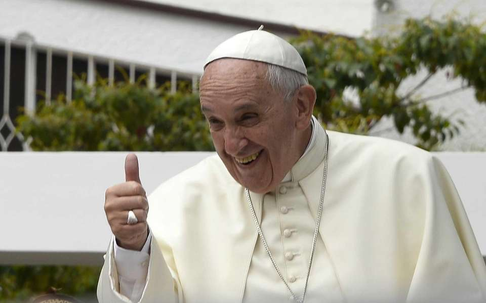 Pope Francis greets followers from the popemobile in