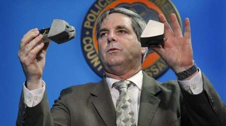 Nassau County Detective Jeffrey Marshall holds up a