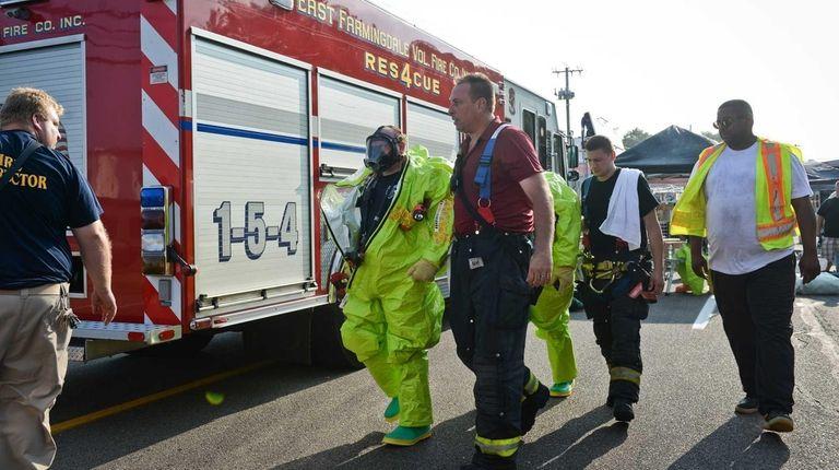 Hazmat technicians prepare to enter the building as