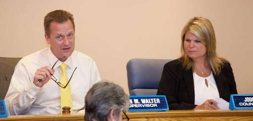 Riverhead Town Supervisor Sean Walter, left, is shown