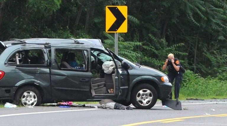 Suffolk County police probe a deadly crash in