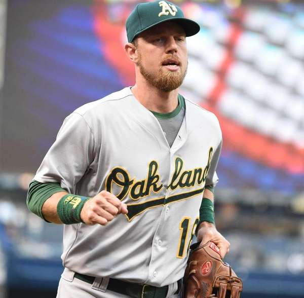 Oakland Athletics leftfielder Ben Zobrist looks on from